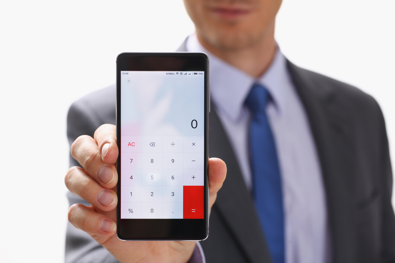 Businessman with Smartphone Calculator